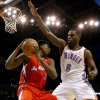 Oklahoma City\'s Nazr Mohammed (8) defends Los Angeles Clippers\' Brian Cook (3) during the NBA basketball game between the Oklahoma City Thunder and the Los Angeles at the Oklahoma City Arena, Wednesday, April 6, 2011. Photo by Bryan Terry, The Oklahoman