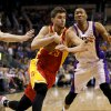 Houston Rockets\' Chandler Parsons (25) drives past Phoenix Suns\' Wesley Johnson during the first half of an NBA basketball game, Monday, April 15, 2013, in Phoenix. (AP Photo/Matt York) ORG XMIT: PNU110