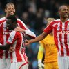 Photo - Stoke City's Peter Crouch, left, with Mame Diouff and Steven N'Zonzi, right, celebrate after their English Premier League soccer match against Manchester City at the Etihad Stadium in Manchester, England, Saturday Aug. 30, 2014. (AP Photo / Lynne Cameron, PA) UNITED KINGDOM OUT - NO SALES - NO ARCHIVES