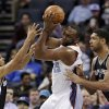 Charlotte Bobcats\' Al Jefferson, center, is trapped by San Antonio Spurs\' Tim Duncan, right, and Cory Joseph, left, during the first half of an NBA basketball game in Charlotte, N.C., Saturday, Feb. 8, 2014. (AP Photo/Chuck Burton)