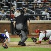 Photo - New York Mets' Eric Campbell, left, slides safely past Philadelphia Phillies catcher Carlos Ruiz, right, for a safe call by home plate umpire Lance Barrett, center, to steal home in the seventh inning of a baseball game at Citi Field, Friday, Aug. 29, 2014, in New York. (AP Photo/Kathy Kmonicek)