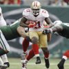 San Francisco 49ers running back Frank Gore (21) breaks through the line of scrimage during the second half of an NFL football game against the New York Jets Sunday, Sept. 30, 2012, in East Rutherford, N.J. (AP Photo/Kathy Willens)