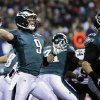 Photo - Philadelphia Eagles' Nick Foles drops back during the first half of an NFL wild-card playoff football game against the New Orleans Saints, Saturday, Jan. 4, 2014, in Philadelphia. (AP Photo/Matt Rourke)