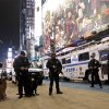 FILE - In this Dec. 31, 2011 file photo, heavily armed police officers stand guard during the New Year\'s Eve celebration in New York's Times Square. The New York City police use an array of security measures for the event that turns the