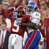 OU\'s Joseph Ibiloye (5) breaks up a pass for KU\'s Jimmay Mundine (41) during the college football game between the University of Oklahoma Sooners (OU) and the University of Kansas Jayhawks (KU) at Gaylord Family-Oklahoma Memorial Stadium on Saturday, Oct. 20th, 2012, in Norman, Okla. Photo by Chris Landsberger, The Oklahoman
