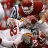 Oklahoma\'s Casey Walker (53) and Tom Wort (21) bring down Iowa State\'s Jeff Woody (32) during a college football game between the University of Oklahoma Sooners (OU) and the Iowa State University Cyclones (ISU) at Gaylord Family-Oklahoma Memorial Stadium in Norman, Okla., Saturday, Nov. 26, 2011. Photo by Bryan Terry, The Oklahoman