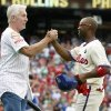 Photo - Philadelphia Phillies' Jimmy Rollins, right, celebrates his single with former Phillies' Mike Schmidt, left, during the fifth inning of a baseball game against the Chicago Cubs, Saturday, June 14, 2014, in Philadelphia. This single gives Jimmy Rollins the all time hits mark for the Philadelphia Phillies over Mike Schmidt. (AP Photo/Chris Szagola)