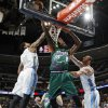 Photo - Milwaukee Bucks center Larry Sanders, center, drives the lane between Denver Nuggets forwards Wilson Chandler, left, and Kosta Koufos for a basket in the first quarter of an NBA basketball game in Denver on Tuesday, Feb. 5, 2013. (AP Photo/David Zalubowski)