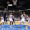 Memphis\' Mike Conley (11) shoots a lay in front of Oklahoma City\'s Reggie Jackson (15), Oklahoma City\'s Serge Ibaka (9), Oklahoma City\'s Kevin Durant (35) and Oklahoma City\'s Derek Fisher (6) during Game 5 in the second round of the NBA playoffs between the Oklahoma City Thunder and the Memphis Grizzlies at Chesapeake Energy Arena in Oklahoma City, Wednesday, May 15, 2013. Photo by Sarah Phipps, The Oklahoman
