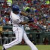 Photo -   Texas Rangers' Adrian Beltre (29) connects for a two-run home run off of Cleveland Indians' Jeanmar Gomez in the first inning of a baseball game, Wednesday, Sept. 12, 2012, in Arlington, Texas. The shot scored Josh Hamilton. (AP Photo/Tony Gutierrez)
