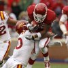 Oklahoma\'s Roy Finch (22) is brought down by Iowa State\'s Jacques Washington (10) during a college football game between the University of Oklahoma Sooners (OU) and the Iowa State University Cyclones (ISU) at Gaylord Family-Oklahoma Memorial Stadium in Norman, Okla., Saturday, Nov. 26, 2011. Photo by Bryan Terry, The Oklahoman
