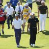 Rickie Fowler of the US, left, and Sergio Garcia of Spain walks up to the 13th green during the first day of the British Open Golf championship at the Royal Liverpool golf club, Hoylake, England, Thursday July 17, 2014. (AP Photo/Scott Heppell)
