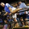 Guthrie head coach Rafe Watkins climbs over a railing and onto the field after a high school football game between Guthrie and Guymon at Jelsma Stadium in Guthrie, Okla., Friday, Sept. 21, 2012. Watkins was suspended for 8 games dating back to last season. This game was the last in his suspension. Photo by Nate Billings, The Oklahoman