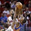 Photo - Miami Heat forward Udonis Haslem, rear, and guard Toney Douglas (0) prevent a pass by New York Knicks guard J.R. Smith (8) during the first half of an NBA basketball game, Sunday, April 6, 2014, in Miami. (AP Photo/Wilfredo Lee)