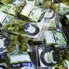Photo - In this photo taken Tuesday, July 1, 2014, packets of a variety of recreational marijuana named