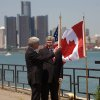 Photo - FILE - In this June 15, 2012 file photo, Canada Prime Minister Stephen Harper right, and Michigan Governor Rick Snyder chat on the banks of the Detroit River in Windsor, Ontario, Canada.  The omission in the federal budget for funding specifically for a border inspection plaza in Michigan is not expected to delay efforts to build a commuter bridge connecting Detroit with Canada, state officials say. Land acquisition for the New International Trade Crossing could start this summer on the U.S. side of the Detroit River, with bridge construction scheduled to begin in 2016. The project would be completed in 2020. The span would compete for the lucrative cross-border toll revenues in Detroit and Windsor, Ont., mainly being captured by the privately owned Ambassador Bridge.  (AP Photo/The Canadian Press,Mark Spowart )