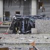 The wreckagew of a car lies outside a building in the centre of Oslo, Friday July 22, 2011, following an explosion that tore open several buildings including the prime minister\'s office, shattering windows and covering the street with documents and debris. A loud explosion shattered windows Friday at the government headquarters in Oslo which includes the prime minister\'s office, injuring several people. Prime Minister Jens Stoltenberg is safe, government spokeswoman Camilla Ryste told The Associated Press.(AP Photo / Thomas Winje, Scanpix Norway) NORWAY OUT ORG XMIT: LON828
