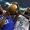 Philadelphia 76ers\' Thaddeus Young (21) and Boston Celtics\' Kevin Garnett (5) vie for a rebound in the first quarter of an NBA basketball game in Boston, Saturday, Dec. 8, 2012. (AP Photo/Michael Dwyer)