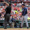 Photo - Atlanta Braves manager Fredi Gonzalez, right, ejected from the game while arguing with home plate umpire Ron Kulpa, left, during the fifth inning of a baseball game against the St. Louis Cardinals on Saturday, May 17, 2014, in St. Louis. (AP Photo/Jeff Roberson)