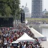 People crowd around the Reflecting Pool at they attend a rally to commemorate the 50th anniversary of the 1963 March on Washington on Saturday, Aug. 24, 2013, in Washington. (AP Photo/Jon Elswick)