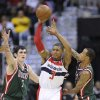 Photo -   Washington Wizards guard Bradley Beal (3) tries to make a pass against Milwaukee Bucks forward Ersan Ilyasova (7), of Turkey, and Monta Ellis, right, during the first half of an NBA basketball game on Friday, Nov. 9, 2012, in Washington. (AP Photo/Nick Wass)