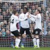 Photo - Manchester United's Danny Welbeck, centre, celebrates with teammates Wayne Rooney, right, and Adnan Januzaj after scoring his first goal against Aston Villa during their English Premier League soccer match at Villa Park Stadium, Birmingham, England, Sunday Dec. 15, 2013. (AP Photo/Jon Super)