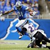 Baltimore Ravens cornerback Jimmy Smith (22) tackles Detroit Lions wide receiver Calvin Johnson (81) during the third quarter of an NFL football game in Detroit, Monday, Dec. 16, 2013. (AP Photo/Paul Sancya)