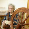 "Instructor Wanda Nobbe at the spinning wheel. ""Hair"" is spun into yarn for weaving project. Community Photo By: Bob Bozarth Submitted By: Sue, Guthrie"