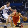 Houston Rockets guard Jeremy Lin, right, drives past Orlando Magic guard Beno Udrih (19) during the first half of an NBA basketball game in Orlando, Fla., Friday, March 1, 2013. (AP Photo/Phelan M. Ebenhack)