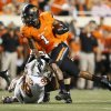 OSU\'s Joseph Randle (1) carries the ball past UT\'s Desmond Jackson (99) during a college football game between Oklahoma State University (OSU) and the University of Texas (UT) at Boone Pickens Stadium in Stillwater, Okla., Saturday, Sept. 29, 2012. Photo by Nate Billings, The Oklahoman