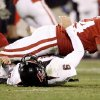 OU\'s Jeremy Beal falls onto Graham Herrel of Texas Tech after a play during the college football game between the University of Oklahoma Sooners and Texas Tech University at Gaylord Family -- Oklahoma Memorial Stadium in Norman, Okla., Saturday, Nov. 22, 2008. BY BRYAN TERRY, THE OKLAHOMAN
