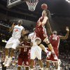 Oklahoma\'s Cade Davis (34) pulls in a rebound over Oklahoma\'s Obi Muonelo (2) in the second half of the college basketball game during the men\'s Big 12 Championship tournament at the Sprint Center on Wednesday, March 10, 2010, in Kansas City, Mo. Photo by Chris Landsberger, The Oklahoman