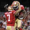 San Francisco 49ers tight end Vernon Davis (85) and quarterback Colin Kaepernick (7) celebrate after connecting on a 3-yard touchdown pass during the first quarter of an NFL football game against the Chicago Bears in San Francisco, Monday, Nov. 19, 2012. (AP Photo/Tony Avelar)