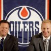 Photo -   Edmonton Oilers general manager Steve Tambellini, left, announces Ralph Krueger, right, as the new head coach for the Edmonton Oilers NHL hockey team in Edmonton, Alberta, Wednesday, June 27, 2012. (AP Photo/The Canadian Press, Jason Franson)