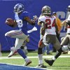 Photo -   New York Giants wide receiver Hakeem Nicks (88) runs past Tampa Bay Buccaneers strong safety Mark Barron (24) for a touchdown during the first half of an NFL football game on Sunday, Sept. 16, 2012, in East Rutherford, N.J. (AP Photo/Bill Kostroun)