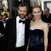 Judd Apatow, left, and Leslie Mann arrive before the 84th Academy Awards on Sunday, Feb. 26, 2012, in the Hollywood section of Los Angeles. (AP Photo/Matt Sayles) ORG XMIT: OSC167