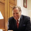 """Photo - In this April 30, 2014 photo, Rep. Mike Rogers, R-Mich, smiles in his office on Capitol Hill in Washington, Wednesday, April 30, 2014. The daily radio show Rogers begins hosting in January will give the Michigan Republican practice talking to millions of Americans every day, and honing what he calls a """"productive conservative"""" message talk radio is desperately lacking, he said. (AP Photo/Lauren Victoria Burke)"""