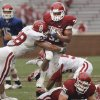 Daniel Franklin (31) is tackled by Travis Lewis (28) during the spring Red and White football game for the University of Oklahoma (OU) Sooners at Gaylord Family/Oklahoma Memorial Stadium on Saturday, April 17, 2010, in Norman, Okla. Photo by Steve Sisney, The Oklahoman
