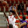 Del City\'s Anthony Holland puts up a shot beside Northwest Classen\'s Trell Harris during the boys Class 5A regional basketball game in Del City, Okla., Saturday, Feb. 25, 2012. Photo By Bryan Terry, The Oklahoman