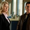This undated publicity photo released by Paramount Pictures shows, from left, Rosamund Pike as Helen, and Tom Cruise as Reacher, in the film,
