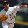 Photo - Colorado Rockies starting pitcher Jorge De La Rosa works against the Washington Nationals in the first inning of a baseball game in Denver on Wednesday, July 23, 2014. (AP Photo)