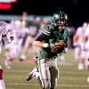 Norman North\'s Jake Higginbotham (12) hauls in a touchdown catch during 6A semifinal football between Owasso and Norman North at Union Tuttle Stadium on November 23, 2012. JOEY JOHNSON/For the Tulsa World ORG XMIT: DTI1211232203119289