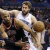 Chicago Bulls forward Taj Gibson, left, loses control of the ball as he tries to shoot in front of Orlando Magic\'s Josh McRoberts, rear, during the first half of an NBA basketball game, Wednesday, Jan. 2, 2013, in Orlando, Fla. (AP Photo/John Raoux)
