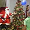 CHILD / KIDS: Santa hits a balloon back to children who were hitting their balloons to each other after they finished their lunch. Santa is played by David Courts. He and other members of the adult singles group from Life Church provided the opportunity for children to visit Santa and to have their pictures taken with him. Oklahoma Rep. Joe Dorman served lunch at the annual holiday carnival for parents and children at Positive Tomorrows , a school for homeless children in Oklahoma City on Tuesday, Dec. 18, 2012. More than 30 volunteers, representing various civic organizations, businesses and churches, helped at the event, sponsoring a wide variety of games and activities for the children. Photo by Jim Beckel, The Oklahoman