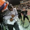 CELEBRATION: Community Christian coach Josh Norman gets splashed with water as they celebrate the Royals win over Windsor Hills during the Christian Schools championship game at Moore High School\'s football stadium in Moore, Oklahoma on Friday, Nov. 12, 2010. Community Christian Schools won the game 64-0. Photo by John Clanton, The Oklahoman ORG XMIT: KOD