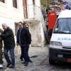 Two neighbors escort Giorgos Tsimirikas, second left, the father of the 3 boys who lost their lives in a fire, away from the burning house, in the village of Mesoropi in northern Greece, Saturday, Dec. 8, 2012. Tsimirikas, his wife and his 6 youngest children were spending the weekend at his parents\' house when the fire broke out early Saturday, caused by a wooden stove. The house had central heating but the owners used a stove because of the steep rise in the price of heating oil as a result of the Greek government\'s recent fiscal measures. (AP Photo/Haris Iordanidis)