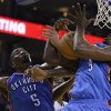 Oklahoma City Thunder\'s Kendrick Perkins (5) and Serge Ibaka (9) fight for a rebound during the second half of an NBA basketball game against the Golden State Warriors Wednesday, Jan. 23, 2013, in Oakland, Calif. (AP Photo/Ben Margot) ORG XMIT: OAS111