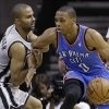 Oklahoma Thunder\'s Russell Westbrook (0) is pressured by San Antonio Spurs\' Tony Parker, left, of France, during the second quarter of an NBA basketball game, Thursday, Nov. 1, 2012, in San Antonio. (AP Photo/Eric Gay) ORG XMIT: TXEG110