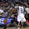 Portland Trail Blazers guard Damian Lillard, left, drives against Sacramento Kings guard Aaron Brooks during the first half of an NBA basketball game in Sacramento, Calif., Tuesday, Nov. 13, 2012. (AP Photo/Rich Pedroncelli)