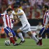 Photo - Real Madrid James Rodriguez from Colombia, center, duels for the ball with Atletico Madrid's Tiago from Portugal, left, and Juan Fran during a Spanish Super Cup soccer match at the Vicente Calderon stadium in Madrid, Spain, Friday, Aug. 22, 2014 . (AP Photo/Daniel Ochoa de Olza)